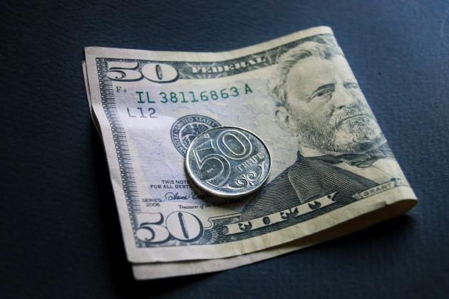Доллар закрыл торги на уровне 387,5 тенге