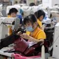 Китай понизил цель поВВП до6,5%