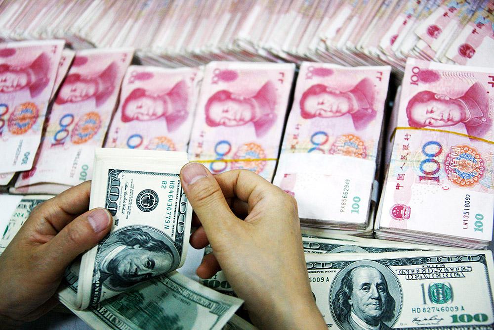 Юань: самая длительная девальвация в истории - Фото