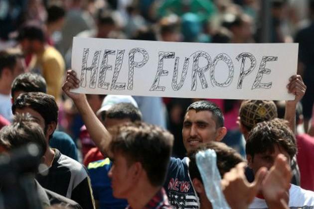 Олланд и Меркель согласовали меры по проблеме с мигрантами