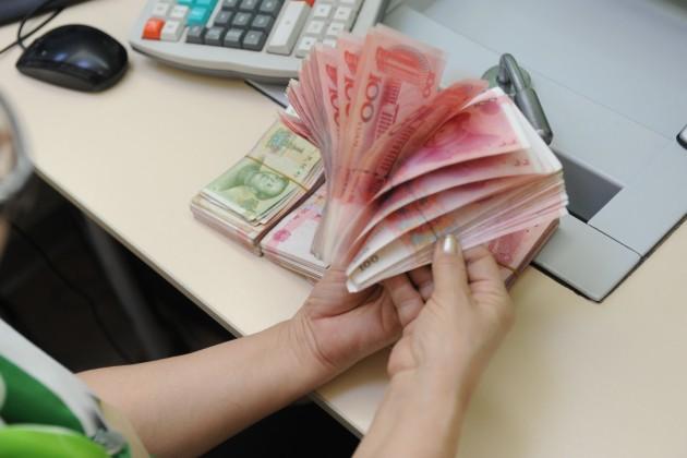 Юань упал кдоллару доминимума с2008года