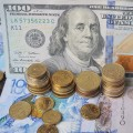 Тенге начал торги сотметки 360за доллар