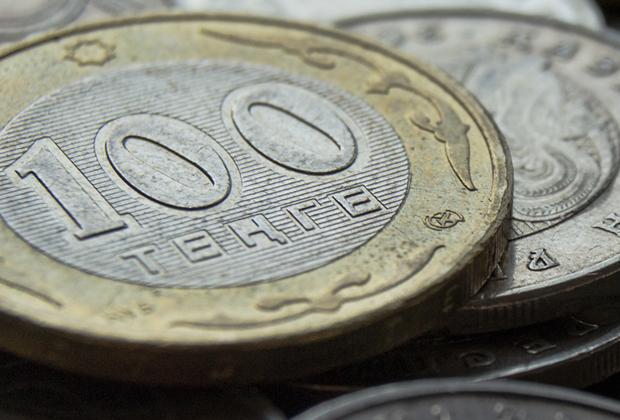 Торги закрылись на отметке 384,21 тенге за доллар