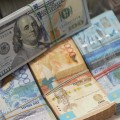 Курс доллара наKASE приблизился к315тенге